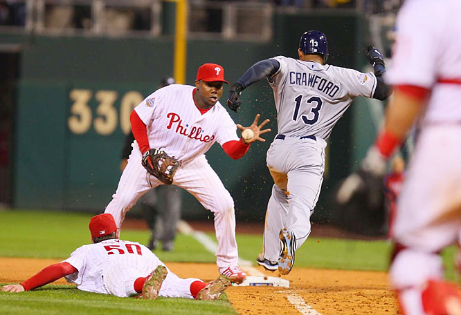 Moyer left everything on the field in Game 3. Here he's lying on the turf after diving to field Carl Crawford's drag bunt in the seventh inning. Crawford was called safe, but replays appeared to show the ball beat him to the bag.