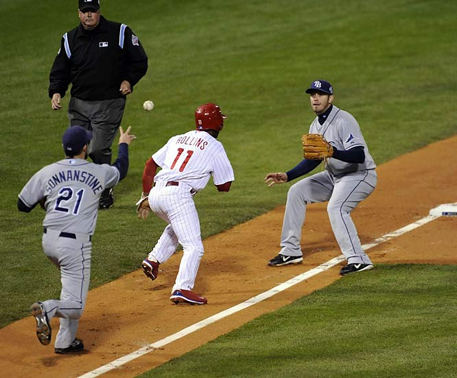Caught in a run-down, Jimmy Rollins races back to third. Replays appeared to show that he was tagged before he made it to the base, but Rollins was called safe, loading the bases. He scored the game's first run when the next hitter, Pat Burrell, walked.