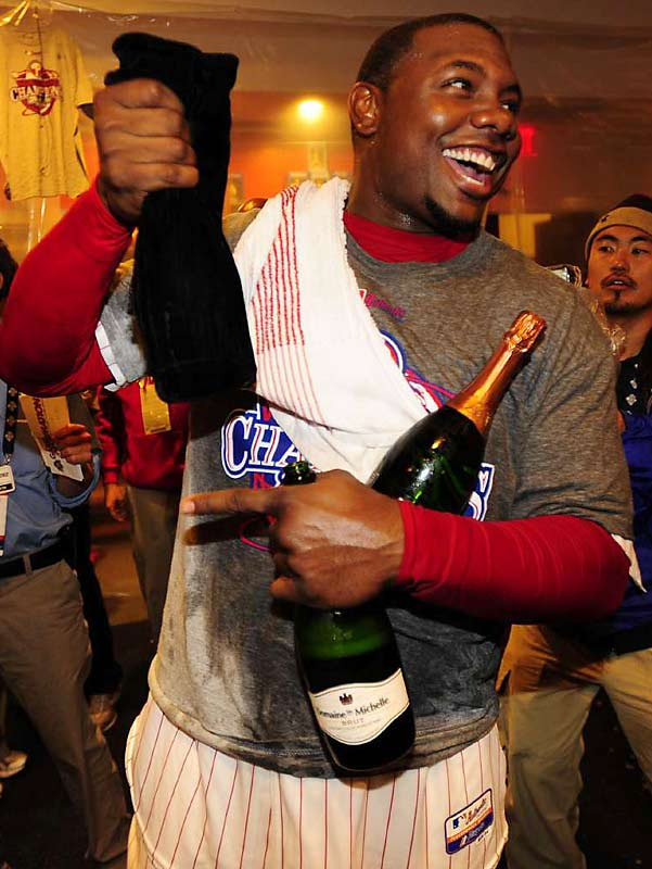 After a tough start to the postseason, Howard hit .286 with three home runs and six RBI against the Rays. Surrounded by photographers and soaked by champagne, he celebrates the Phillies' win in the clubhouse.