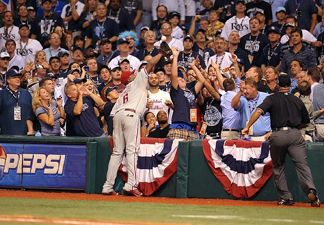 Howard reaches into the stands to catch a foul ball, but his postseason struggles at the plate continued with an 0-4, three strikeout performance in the Series opener.