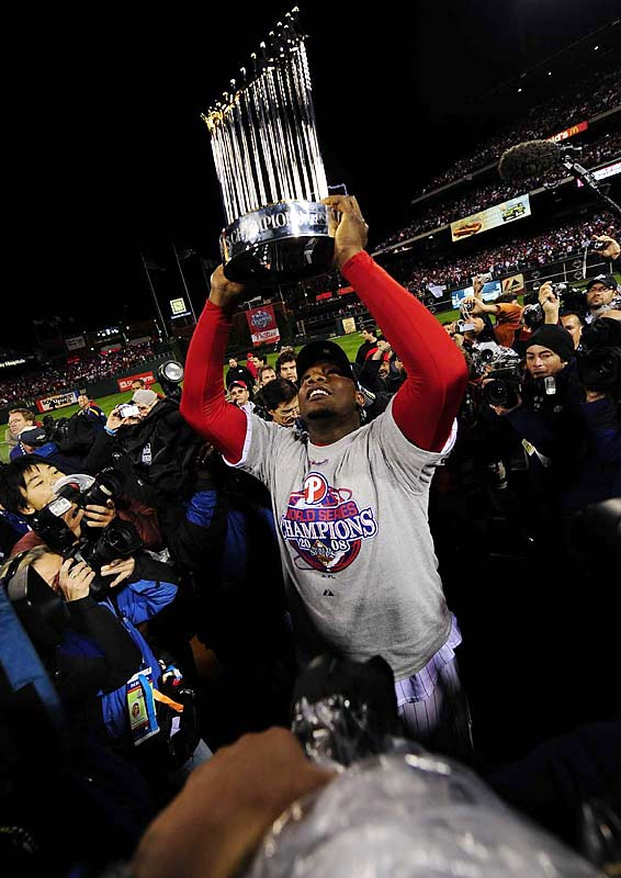 Ryan Howard hoists the Commissioner's Trophy after the Phillies 4-3 victory Wednesday night. Howard struggled against lefties during the World Series, but he exploded for two home runs and five RBI in his club's 10-2 Game 4 win.