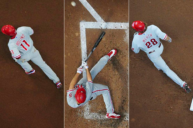 Jimmy Rollins led off the game with a home run, Pat Burrell hit two more round-trippers and Jayson Werth added a solo shot as the Phillies romped into the NLCS.
