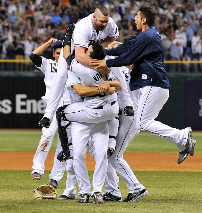Tampa Bay players swarm David Price after he recorded the final out of Game 7. ''I wanted the ball,'' Price said afterwards. ''I think everybody down there in the 'pen wanted the ball tonight.''