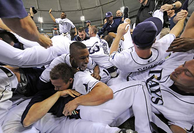 The Rays piled into a celebratory heap on the infield Sunday. Tampa Bay is four wins away from becoming the first team to go from worst in the majors to World Series champion in just one season.