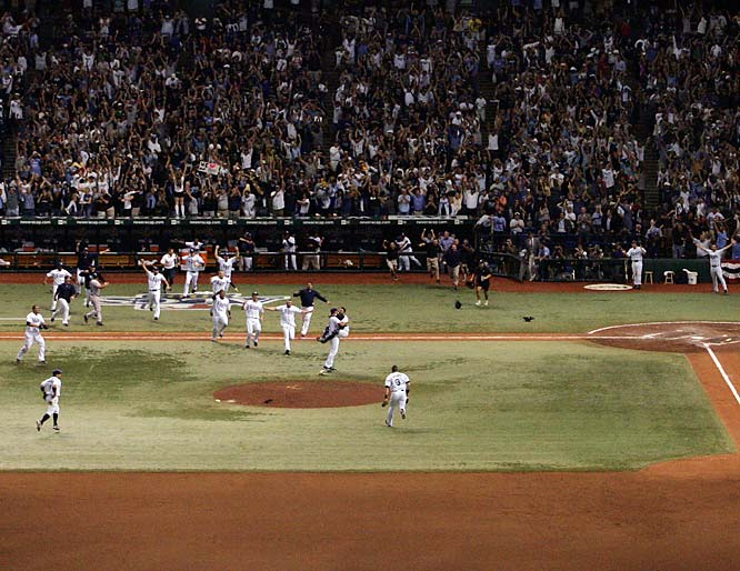 Tampa Bay players pour out of the dugout after Akinori Iwamura's put out ended Game 7, sending the Rays to the World Series. The Rays were a 200-1 shot to win the World Series when the season started.