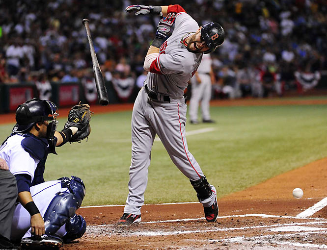 Sox second baseman Dustin Pedroia reacts after being hit by a Matt Garza fastball. Pedroia accounted for Boston's only run in Game 7 with a first inning home run, his third of the series.