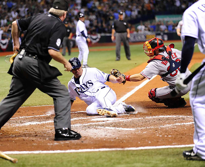 Carlos Pena, sliding in ahead of a tag by Jason Varitek, was one of three Rays to hit at least three home runs during the ALCS. He hit three, while B.J. Upton and Evan Longoria each hit four.