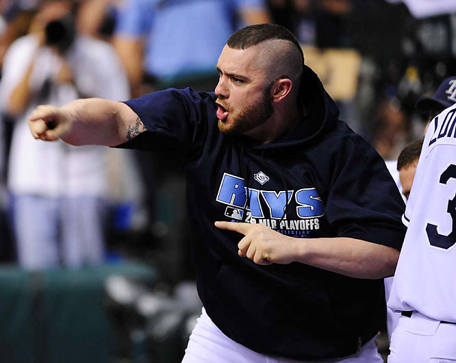 Jonny Gomes celebrates on the field following the Rays win. Tampa Bay has a couple of days to rest before the Phillies come to Florida for the start of the World Series.
