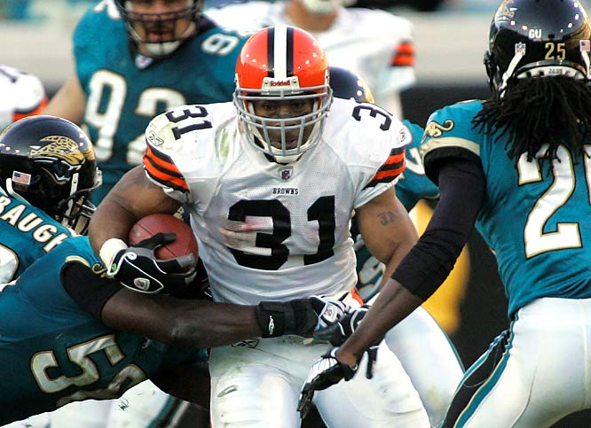Cleveland running back Jamal Lewis rushed for 81 yards and a touchdown, and defensive tackle Shaun Rogers dominated all over the field as the Browns beat the Jacksonville Jaguars 23-17.