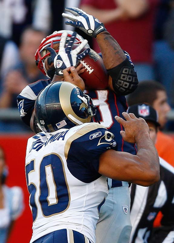 Kevin Faulk grabbed a 15-yard touchdown pass with 3:13 left - holding onto the ball while being hit by St. Louis linebacker Pisa Tinoisamoa. The score put the Patriots up for good, and gave Jim Haslett his first loss as Rams coach since taking over the club from Scott Linehan.