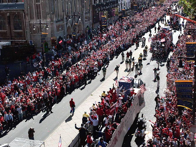 Thousands of Phillies fans lined up 10 deep along downtown sidewalks on Broad Street.