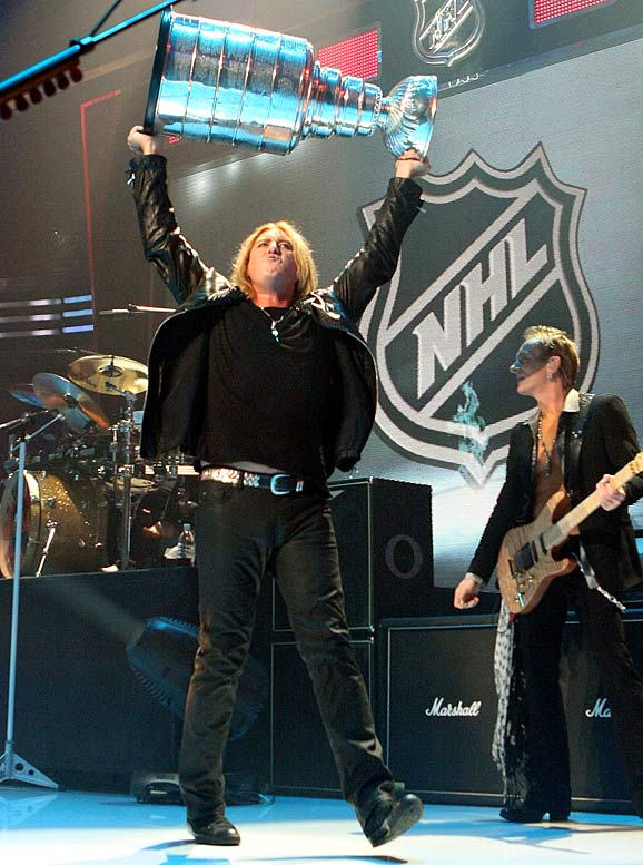 If having a band like Def Leppard as the live act for the Detroit Red Wings' opening night game wasn't already bad enough, Wings fans and players had to watch Joe Elliot take the cup and place it upside down during a pregame concert that was as painful to watch as the actual game with the Wings losing to the Maple Leafs 3-2.