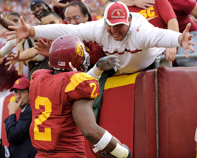 "USC superfan Manuel Hernandez probably thought it was lame to settle for shouting ""good job"" to C.J. Gable, so instead he tried to give the Trojan back a big, celebratory hug."