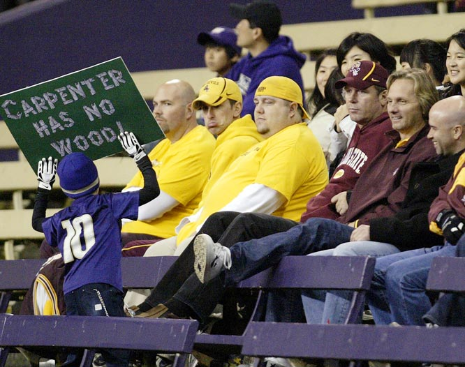 "This young Huskies fan can't root for a good football team, so he has no choice but to make pithy (albeit witty) signs that say, ""It burns when Sparky pees."""