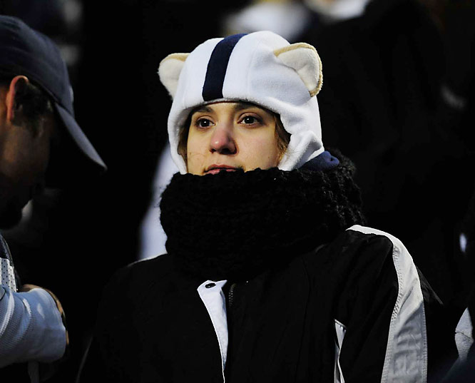 It's a good thing this Penn State fan had plenty of head- and -neck gear under which to hide after her then No. 3 Lions lost on a last-second Iowa field goal.