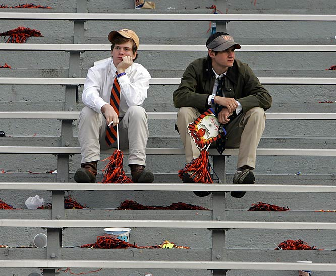 These two Auburn fans couldn't tear themselves away from the wreckage after Auburn fell to conference rival Georgia.