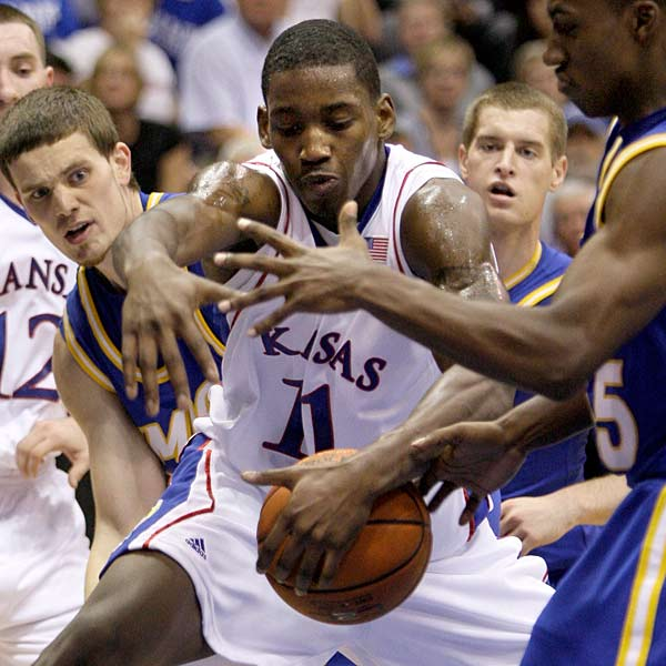 Looking quite different from the team that cut down the nets last season, Kansas topped UMKC 71-56.  Sherron Collins led the Jayhawks with 16 points, and fans got a chance to get a first look at the team's freshmen, including Quintrell Thomas (pictured).