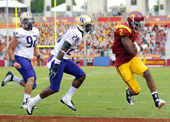 C.J. Gable (left) gained 108 yards on 10 carries and scored twice in the rout. The Trojans had 18 first downs and 325 yards of total offense in the first half, compared to two first downs and 35 yards for the Huskies. USC emptied its bench in the second half.