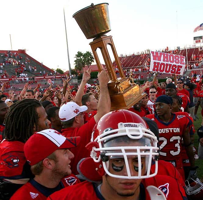 Houston Cougars vs. Rice Owls    Trophy introduced in 1974.
