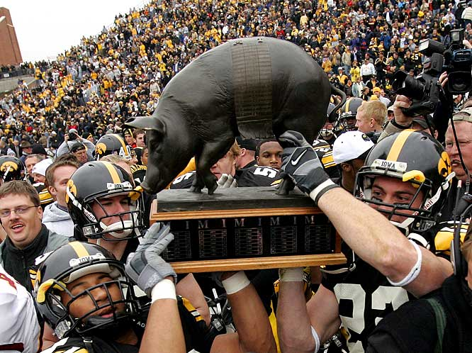 Iowa Hawkeyes vs. Minnesota Golden Gophers    Trophy introduced in 1935.