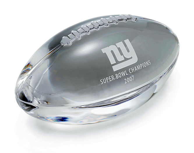 The New York Giants have partnered with Tiffany & Co. to create the New York Giants Super Bowl XLII Collection featuring the Super Bowl Champions 2007 commemorative logo on a variety of special and unique items from cufflinks and money clips to paperweights (shown here) and crystal tumblers.