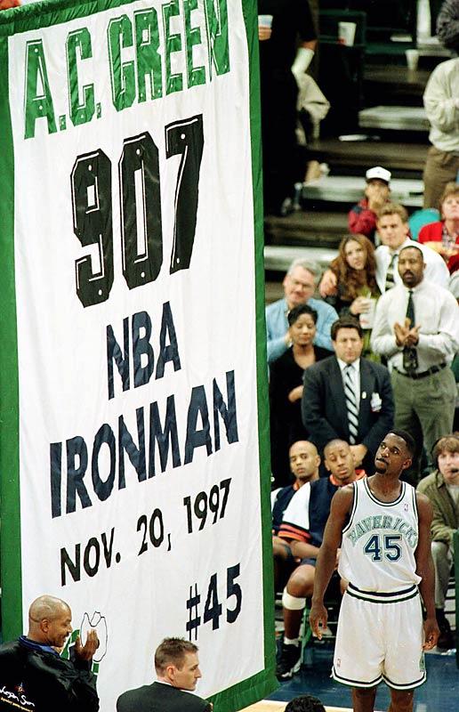 Dallas forward A.C. Green ties Randy Smith's NBA record of 906 consecutive games.