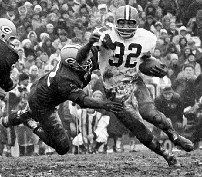 Cleveland running back Jim Brown rushes for an NFL record 242 yards and four touchdowns as the Browns beat the Philadelphia Eagles, 45-24.
