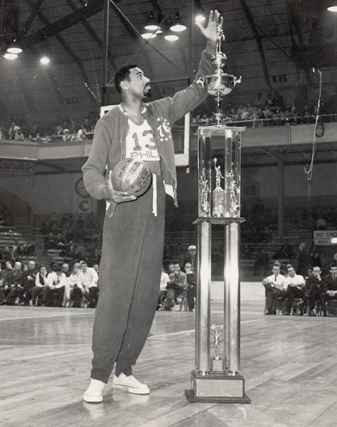 Philadelphia's Wilt Chamberlain grabs an NBA record 55 rebounds in a 132-129 loss to Boston.
