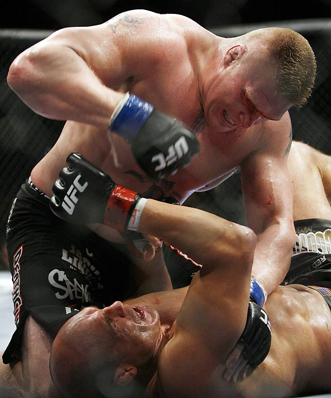 After an exchange of knees, Lesnar swooped in for the takedown, landed a hard right and unleashed a flurry of punches on Couture. The ref called the fight at 3:07 in Round 2, and Lesnar joined interim champ Antonio Rodrigo Nogueira as one of the UFC's two heavyweight titleholders.