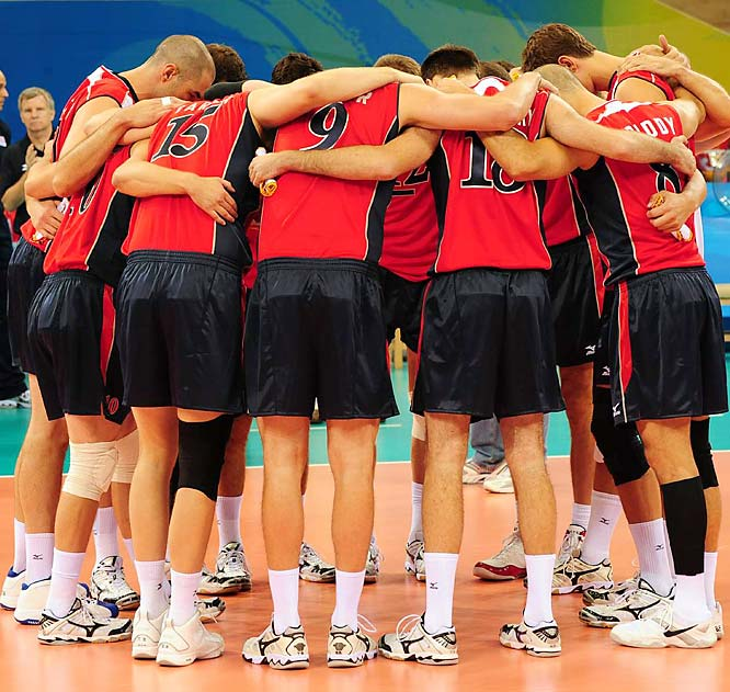 "Nominated by Brian Cazeneuve<br><br>""In the locker room of Beijing's Capital Gymnasium, members of the U.S. men's Olympic volleyball team interrupted their greatest moment of celebration for a moment of silence, a private tribute for a fallen family member whose memory they had just honored with the most stirring victory in the team's history. One by one, the players reached out to Hugh McCutcheon, their coach and pillar of strength, unsure whether to high-five or break down, to laugh or cry. 'An impossible mix of emotions,' said veteran setter Lloy Ball, whose tears were dripping onto the strap that held the gold medal around his neck."""