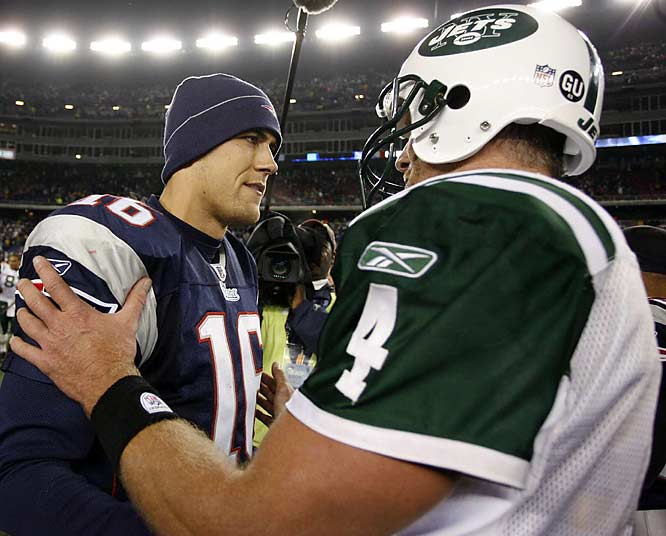 Brett Favre and Matt Cassell meet at midfield after the Jets' 34-31 overtime victory. The win gave the Jets (7-3) sole possession of first place in the AFC East for the first time since Nov. 19, 2001.