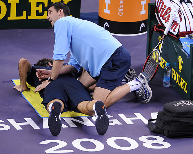 Federer, a four-time winner of the season-ending tournament, appeared to be bothered by a sore back that forced him to withdraw during the Paris Masters two weeks ago. Federer received treatment from the trainer three times during the match.