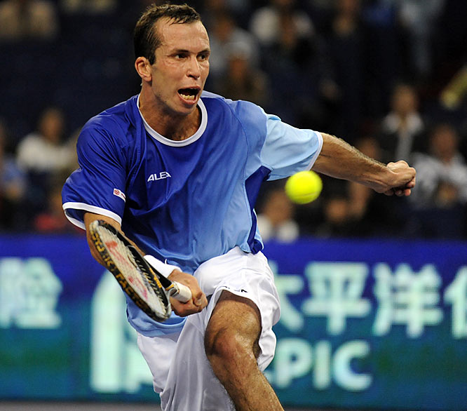 Radek Stepanek of the Czech Republic returns a shot to Roger Federer in round robin play.