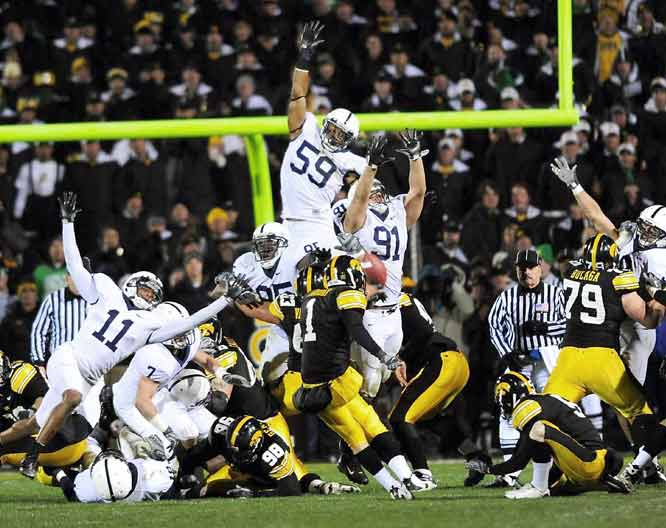 Shonn Green rushed for 117 yards and two touchdowns, and Daniel Murray hit this 31-yard field goal with one second left. Iowa's rally stunned Penn State and all but ended their BCS title hopes.