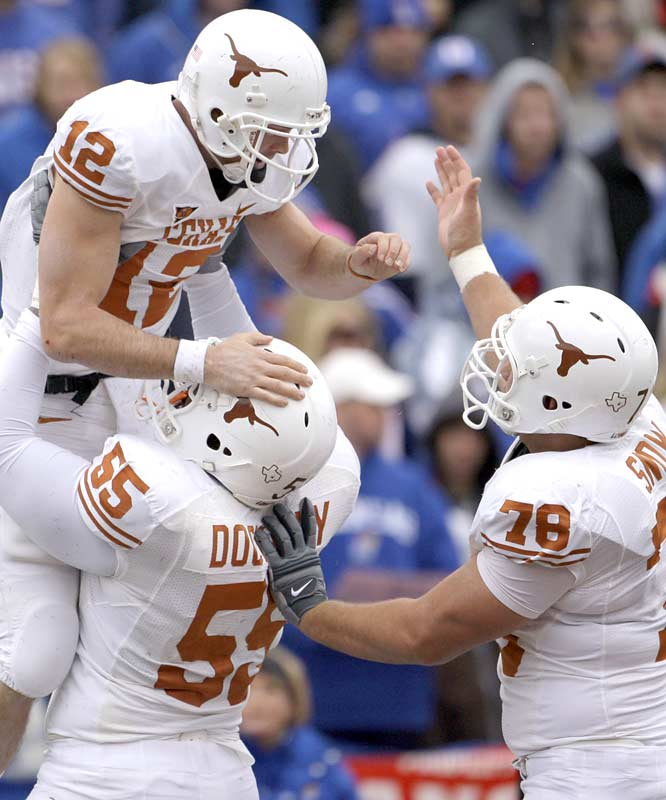 QB Colt McCoy had no trouble jumping for joy over the Longhorns' decisive road victory. On the day, McCoy accounted for three scores and 333 total yards.