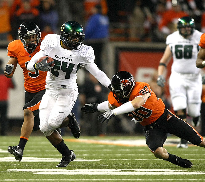 Jeremiah Johnson ran for 219 yards and a touchdown as the Ducks won the Civil War and delivered a serious blow to Oregon State's Rose Bowl hopes.