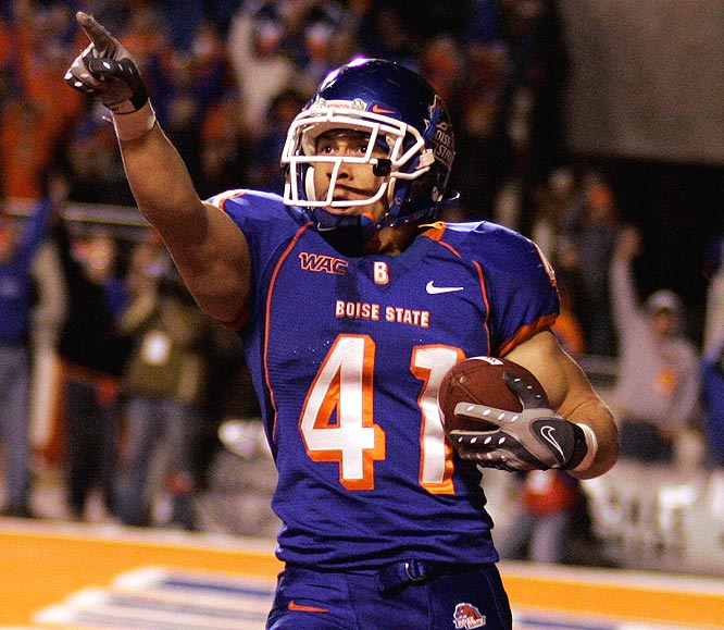 Boise State running back Ian Johnson celebrates his 57th career touchdown, tying the WAC record set by Marshall Faulk at San Diego State from 1991-93.