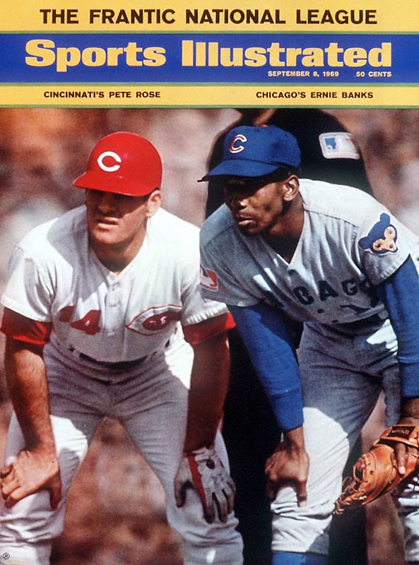 In baseball's first season of division play, the Cubs and Reds (led by Ernie Banks and Pete Rose, respectively) were both locked in tough races. The Cubs led the East for most of the season, but lost 17 1/2 games to the Mets in the last quarter of the season to finish second. In the NL West, Rose posted his best offensive season, but saw his club finish third.
