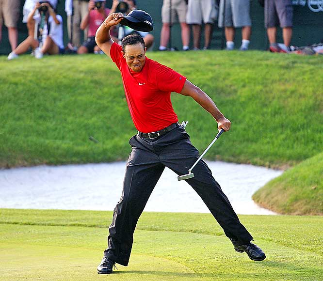 Tiger Woods celebrates making a birdie on the 18th to win the Arnold Palmer Invitational on March 16 at the Bay Hill Club and Lodge in Orlando.