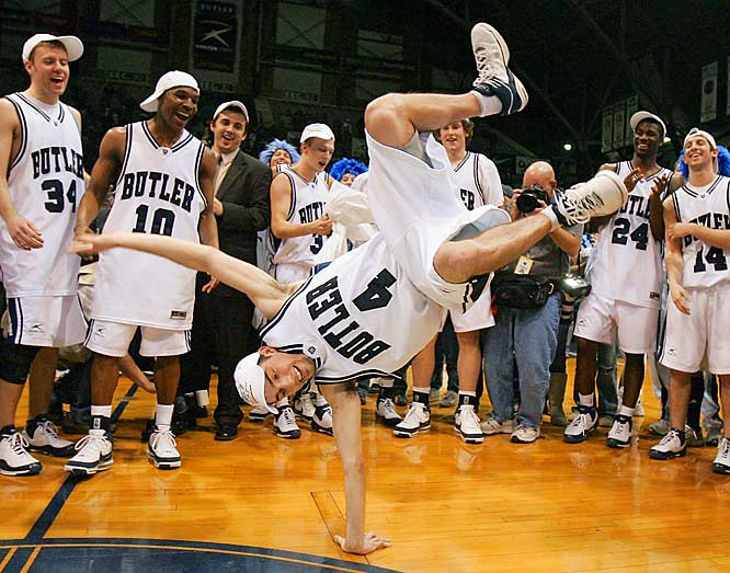 Not to be outdone, guard A.J. Graves does a cartwheel  following Butler's 70-55 victory over Cleveland State to win the championship game at the Horizon League Conference tournament in Indianapolis,