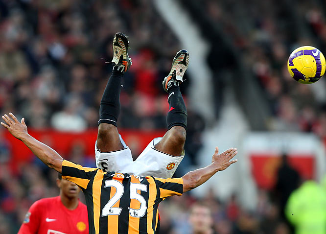 By now you've perused SI's Photos of the Year. Here are some of the year's best photos from some other photo agencies, beginning with Manchester United's Patrice Evra, top, vying with Hull City's Daniel Cousin, bottom, during their English Premier League match on Nov. 1.
