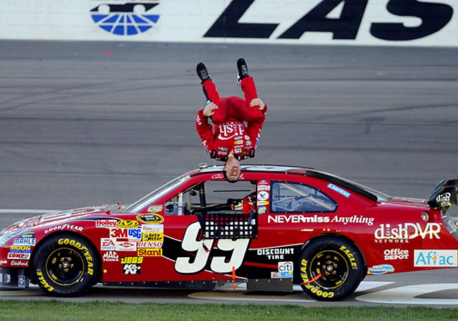Carl Edwards does his trademark backflip celebration after winning NASCAR's Sprint Cup Series UAW-Dodge 400 at Las Vegas.