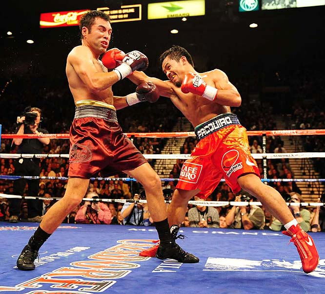 "To kick of his successful year, Manny Pacquiao claimed the WBC and The Ring super featherweight titles after defeating Juan Manuel Marquez in a rematch on March 15. The victory marked the first time a Filipino had won three titles in three weight classes. On June 28, Pacquiao knocked out David Diaz in the ninth round to snag the WBC lightweight belt. Then, on Dec. 6, Pacquiao jumped two weight divisions to take on ""Golden Boy"" Oscar De La Hoya. The Filipino pummeled the boxing legend to earn a ninth-round TKO victory."