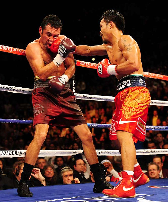 Pacquiao was winning big before the seventh round, when he pounded De La Hoya against the ropes and planted huge shots that knocked him across the ring.