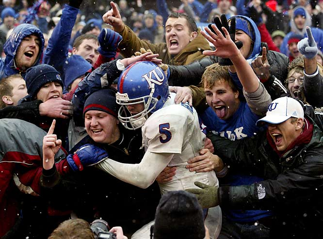 Kansas QB Todd Reesing celebrates with the Jayhawk faithful after connecting for a game-winning touchdown in the final minute against Missouri.