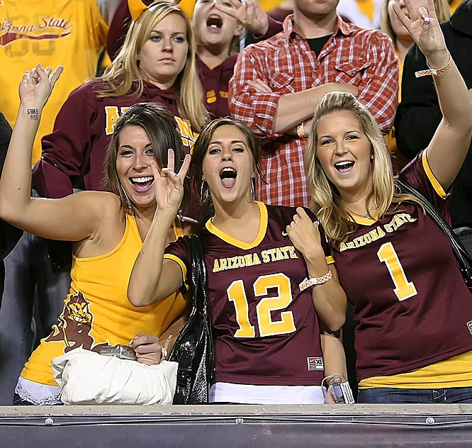 These Arizona State fans proudly flashed their mascot's pitchfork sign while their team obliterated UCLA on the field.
