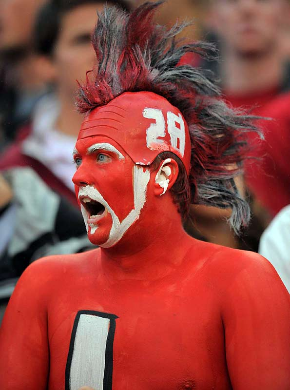 The painted on helmet is a nice touch, but this 'Bama fan gets bonus points for the color-coded mohawk.