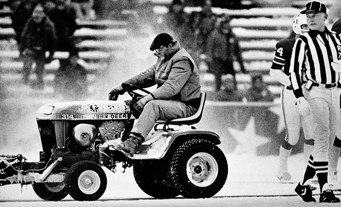 "New England defeats Miami 3-0 in the infamous ""Snowplow Game."" Mark Henderson uses his plow to clear a kicking surface on the Sullivan Stadium turf for John Smith's 33-yard game-winning field-goal."