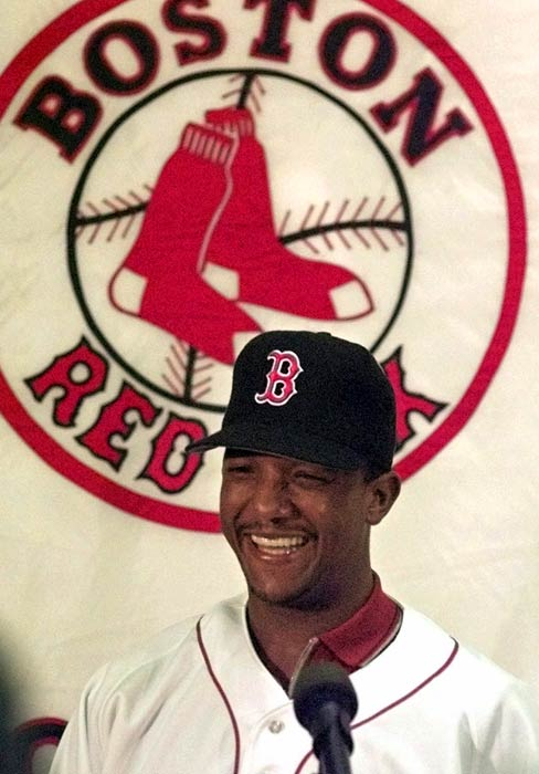 The Red Sox sign Pedro Martinez to a record six-year, $69 million contract.