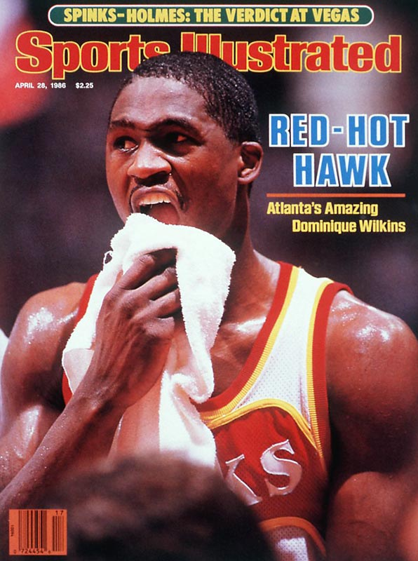 Dominique Wilkins scores 57 points and collects nine rebounds in Atlanta's 123-95 victory over the Bulls.